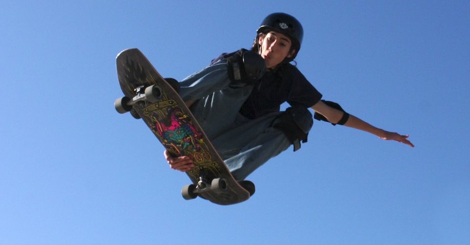 skateboarder doing a trick in the air