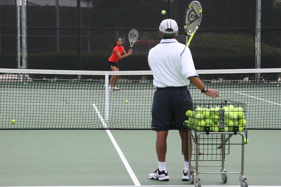 man playing tennis on a tennis court